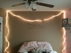 Rope lights above the bed makes the room so much more relaxing! At target for $10 !