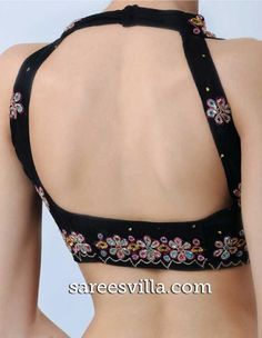 Backless Blouse designs will gives a stylish look for women. We have various tremendous backless blouse designs it will match your sarees and give stylish look to you. Choli Blouse Design, Saree Blouse Neck Designs, Choli Designs, Fancy Blouse Designs, Stylish Blouse Design, Indian Blouse, Indian Sarees, Designer Blouse Patterns, Make Up