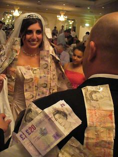 A Happy Bride pinned with money! Read more on http://greekweddingtraditions.com/