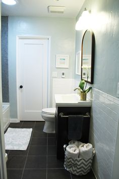 yep. love this: the subway tile halfway up the wall (easy care! looks great!), and the pale wall color with dark vanity & floor and mid-tone, small-scale bathtub tiling.