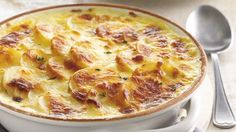 The best potato bake. Try this creamy, cheesy potato bake recipe for a perfect side dish. Braai Recipes, Fish Recipes, Baking Recipes, Potato Recipes, Vegan Recipes, Cheesy Potato Bake, Cheesy Potatoes, Potato Casserole, Best Potato Bake Recipe
