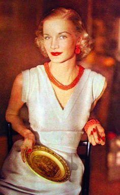 Sunny Harnett.  Vogue, 1951 white sheath day dress red jewelry necklace bracelet supermodel 50s portrait icon