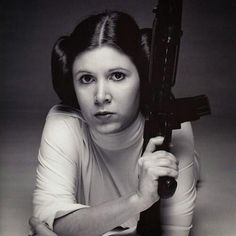 I love, love, LOVE this picture of Carrie Fisher. Princess Leia will forever be the most badass princess ever