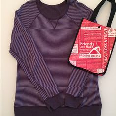 Lululemon Reversible Open Your Heart Sweatshirt Lululemon Open Your Heart reversible long sleeve sweatshirt. Size 10. Excellent used condition! Super cute purple stripes on one side and reverse side is a beautiful solid plum color. Small Lululemon reusable bag included! No trades! Bundle to save! Thank you! lululemon athletica Tops Sweatshirts & Hoodies