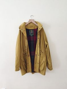 Love mustard colored clothing items. I think that the red and green plaid inside goes well with this color too