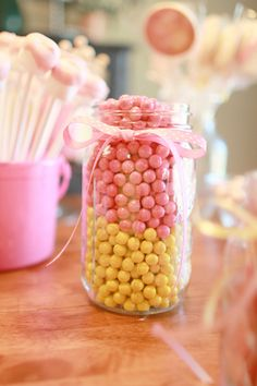 Pink and yellow candies in a jar. Sweet decoration for a lemonade party.