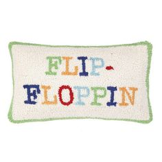 Hand-hooked wool and cotton pillow with a typographic motif.   Product: PillowConstruction Material: Wool and co...