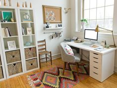 Keep your workspace uncluttered and your tasks organized with open shelving and stylish boxes for out-of-sight storage. Just look down for inspiration – an Aztec rug infuses color and texture in an otherwise unadorned office.