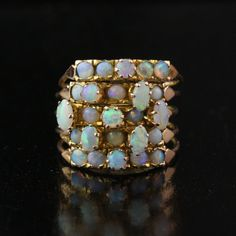Antique Hinged Opal Ring c. 1880 14k rose gold; 25 oval and round black crystal opal cabochons