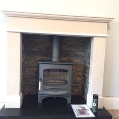 This Charnwood c-five in gun metal looks fantastic with a bespoke limestone fire… This Charnwood c-five in gun metal looks fantastic with a bespoke limestone fireplace and oyster slate chamber. Wood Burner Fireplace, Wood Burning Fireplace Inserts, Wooden Fireplace, Fireplace Garden, Limestone Fireplace, Home Fireplace, Fireplace Surrounds, Fireplace Mantels, Fireplaces