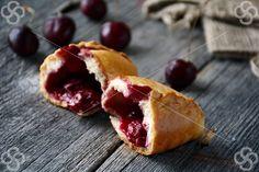 Pierozhki with sour cherries on @studentstock