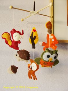 Woodland creature mobile. I can make something like this for my boy.