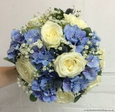 Ivory and Blue Wedding Flowers Hand-tied Bridal Bouquet with Roses, Pale Blue Hydrangea, Eryngium, Gypsophila and Eucalyptus | Wedding Flowers Liverpool, Merseyside, Bridal Florist, Booker Flowers and Gifts, Booker Weddings