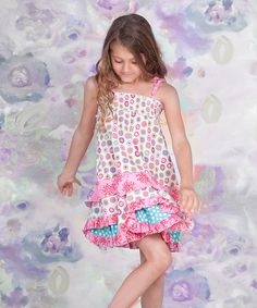 <p+style='margin-bottom:0px;'>Stylish+sweeties+dance+with+steps+of+delight+in+this+fanciful+frock,+thanks+to+its+sweet+array+of+prints,+smocked+panel+and+tiered+ruffles.+The+pullover+design+with+stretchy+smocking+and+tie+straps+makes+it+easy+for+cuties+to+get+dressed+each+morning.<p+style='margin-bottom:0px;'><li+style='margin-bottom:0px;'>100%+cotton<li+style='margin-bottom:0px;'>Machine+wash<li+style='margin-bottom:0px;'>Imported<br+/>