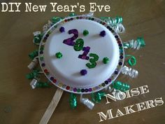 DIY New Year's Eve Noise Makers made with paper plates and pasta!  A fun kid's craft!