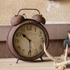 Antique Rust Metal Alarm Clock  made by Charming Accessories For Any Space.