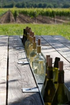 Picnic table with built in beverage chiller. Love this idea for the traditional picnic table.