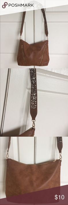 Purse Faux leather/suede purse; has long shoulder strap with laser cut outs; brand new never used! Bags Crossbody Bags
