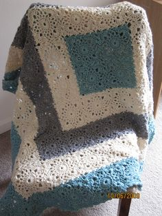 """Square Upon Square throw, free pattern (no. WR1850) by Katherine Eng for Red Heart.  Lacy motifs that are JAYG.  57"""" square, 2560 yds worsted 10-ply, hook size 'I'. Pic from Ravelry Project Gallery by amgfl78  . . . .   ღTrish W ~ http://www.pinterest.com/trishw/  . . . .   #crochet #afghan #blanket"""
