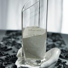 The glass vase is pre-printed with the message 'In Our Hearts Forever' and 4 lines of custom text can be added at no additional cost.