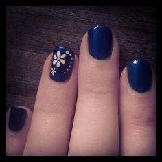 Electric blue white flower hand painted nail art