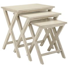 Set of three wood nesting tables with X-legs.   Product: Small, medium and large nesting tableConstruction Material: Solid woodColor: CreamDimensions: 22.8 H x 24.4 W x 16.5 D (overall)