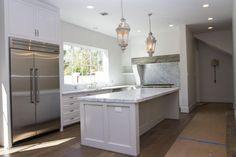 Gourmet kitchen with commercial cook-top oven.