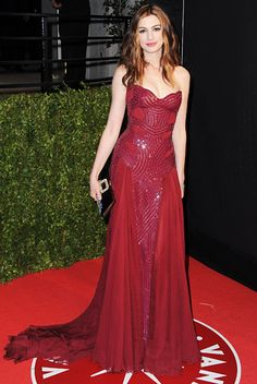 The maroon strapless Versace gown she chose for the Vanity Fair party was the most glam.
