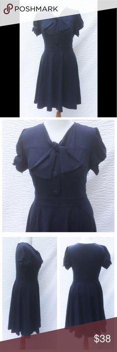 """New Eshakti Retro Navy Fit & Flare Dress XL 18 New Eshakti navy knit retro style fit & flare dress XL 18 Measured flat: underarm to underarm: 41"""" Waist: 37"""" Length: 41"""" Eshakti size guide for XL 18 bust: 43 1/2"""" Short fabric covered button front closure. Princess seamed bodice, banded waist, side hidden zipper, side seam pockets, flared skirt, below knee length. Short sleeves w/ partial elastic at cuff. Cotton/spandex, woven jersey knit, light stretch. Machine wash. New w/cut out Eshakti tag…"""