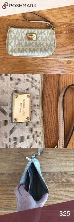 Michael Kors wristlet Ivory and Beige MK wristlet with inside pocket. Great condition! KORS Michael Kors Bags Clutches & Wristlets
