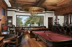 """""""mancave"""" complete with bar, pool table and poker table."""