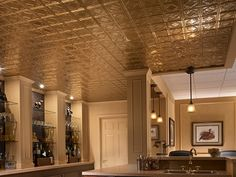 Chrome-plated Armstrong's Metallaire drop panel ceiling reflects a sophisticated aesthetic in this basement's bar. Armstrong Ceiling, Lighted Bathroom Mirror, Ceiling Decor, Tin Ceiling, Ceiling, Ceiling Design, Ceiling Tiles, Suspended Ceiling Systems, Finishing Basement