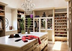 I would love this walk in closet. Best feature the chandelier!!! Bcuz its gonna be in mine!