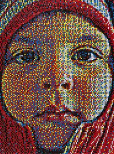 Take a photo, pixelate it, and use a bulletin board and red, yellow, blue, black, and white pushpins to create a photo realistic image.