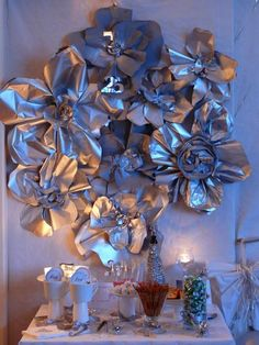 Silver 25th Wedding Anniversary Party. Looks like news paper cutouts spray painted silver...