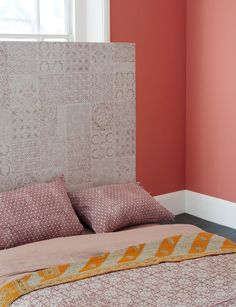 Get creative and use Delicato Rose embossed tiles to create a beautiful headboard. Mandarin Stone.