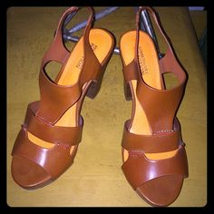 Kenneth Cole heels size 7 These are a great pair of causal heels from Kenneth Cole Reaction. They are a cognac color with a fun pop of orange inside. They have never been worn outdoors and the markings are from the store purchased. Kenneth Cole Reaction Shoes Heels
