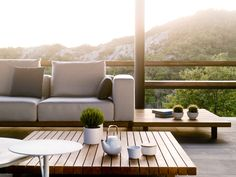 Outdoor modular seating with teak base: Vis à Vis Sofa by Tribù
