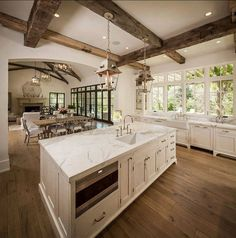 Kitchen sink, big windows.  The set up of island, dining table then living room
