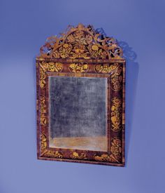 """A Fine William and Mary Walnut and Marquetry Mirror,     CIRCA 1695,     Height: 48"""" Width: 30 ½"""".       Retaining the original cresting; the bevelled plate set within a crossbanded surround, enclosed by an oyster-veneered frame inlaid with elaborate flower panels incorporating various woods."""