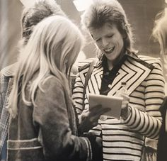 David Bowie signing an autograph