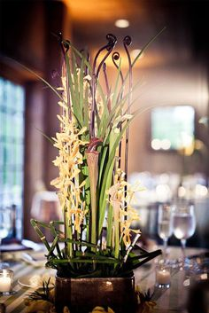 maybe we can mix in a concept like this for our taller centerpieces- but still have low pieces around it?