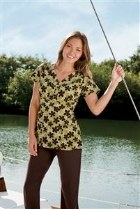 "Jockey Scrubs Patch Pocket Print Top in ""Heather Olive"" 2226-510 Jockey Scrubs Patch Pocket Top    Unbelievable style and practicality.    When fashion and function come together, a favorite top  gets even better. This redesigned top features two  deep external patch pockets in the front, fun prints  and fabric that effortlessly moves with you.  Who could ask for more?  Tri-blend: 72% polyester, 21% rayon, 7% spandex  Length: 26"" Sizes: XS -3X  st yle # 2226    Tri-blend: 72% polyester, 21%…"