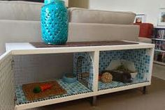 Great idea! It's a coffee table doubled as a rabbits cage. Found on google images