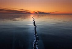 "Photographer Alexey Trofimov captured quite an unusual picture of the ice here. He writes that the ""ice on Lake Baikal is a very interesting phenomenon."" national-geographic"