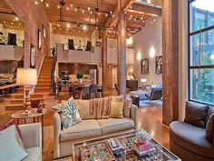light-filled and airy, with a rustic look of old wooden beams and exposed, terra-cotta-coloured brick walls and warm wood floors  Read more at http://houseofanais.onsugar.com/category/interior#1mJiOXoHKWUqyBv5.99