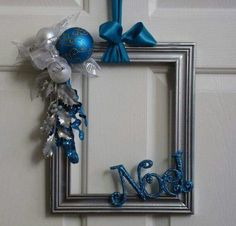 Frame with Noel and decorations on it