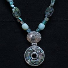 Tuareg mother of pearl and aquamarine necklace.