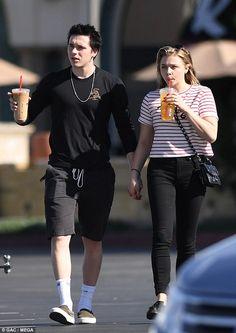 Delicious: The lovebirds got their caffeine fix with iced coffee and tea when they walked through the picturesque streets