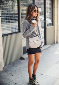 Fall Outfit Inspiration - Fashion blogger and street style star  @sincerelyjules1 wearing a cozy gray turtleneck sweater, Chloé saddle bag, black denim mini skirt + studded ankle boots